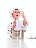 Little singing boy chef in uniform. With ladle stiring in the pot ok sign isolated on white Stock Image