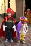 Little Sinterklaas and Zwarte Piet stock images