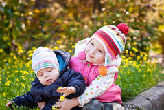 Little sister and baby brother Stock Images