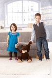 Little sister and brother with teddy bear Royalty Free Stock Photos