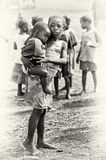 Little sister holds her brother in Ghana Royalty Free Stock Photos