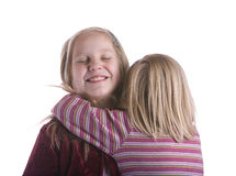 Little Sister Hugs Big Sister Stock Images