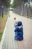 Little sister hugs her toddler brother Stock Photography