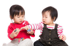 Little sister play together Stock Photos