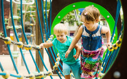 Little sisters at action-oriented playground Royalty Free Stock Photography