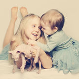 Little sisters baby girl and kittens Royalty Free Stock Photography