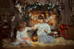 Little sisters  at Christmas Eve Stock Photography