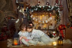 Little sisters  at Christmas Eve Royalty Free Stock Image