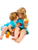 Little sisters with fruit Royalty Free Stock Images