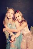 Little sisters girls hugging Stock Image