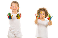 Little sisters girls showing painted hands Royalty Free Stock Photography