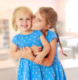 Little sisters kiss Royalty Free Stock Photo