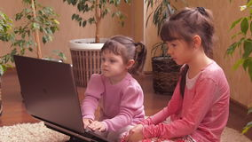 Little sisters with laptop. Full HD stock video footage