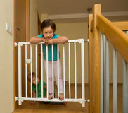 Little sisters near stair gate Royalty Free Stock Photo