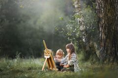 Little sisters painting outdoors Stock Photography