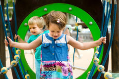 Little sisters at playground in park Royalty Free Stock Photos