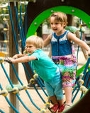 Little sisters at playground in park Royalty Free Stock Photo
