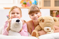 Little sisters playing with bear Royalty Free Stock Photo