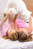 Little sisters playing with bear Royalty Free Stock Photos