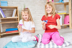 Little Sisters Playing with Popular Toys Royalty Free Stock Photo
