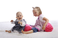 Little sisters playing together Royalty Free Stock Photos