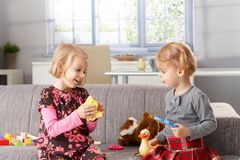 Little sisters playing together at home Royalty Free Stock Photos