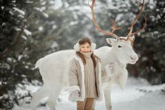 Portrait of beautiful Little girl in fur coat at winter forest stock photo