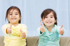 Little sisters thumbs up Stock Images
