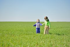 Little sisters walking in a field Royalty Free Stock Images