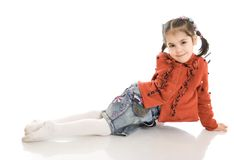 The little sitting girl isolated on a white Stock Photos