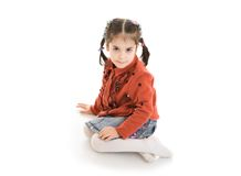 The little sitting girl isolated on a white Royalty Free Stock Images