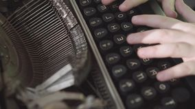 Little six-year-old boy studies the work of an old typewriter. Close-up hands. Little boy with the old typewriter, close up stock video footage