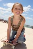 Little skater. Smiling cute girl riding her skateboard Stock Image