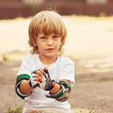 Little Skater taking off gloves Royalty Free Stock Photos