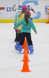 Little skaters Stock Images