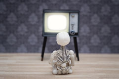 Little skeleton and TV Royalty Free Stock Photography