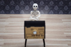 Little skeleton and TV Stock Photo