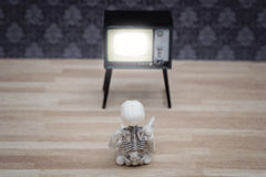 Little skeleton and TV Stock Photos