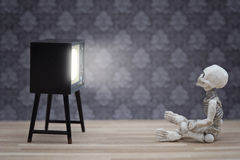 Little skeleton and TV Royalty Free Stock Photos