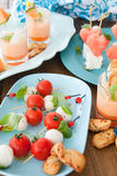 Little skewers with tomatoes Stock Image