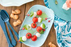 Little skewers with tomatoes Royalty Free Stock Images