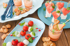 Little skewers with tomatoes Stock Images