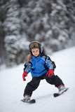Little ski girl Stock Images
