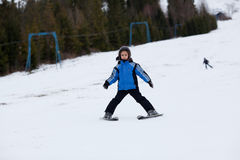 Little ski girl Stock Photos