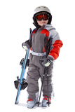 Little Skier. Young child dressed in ski clothing holding ski equipment...isolated view Stock Photo