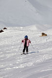 Little skier and dog on ski slope at sun winter day Royalty Free Stock Photos