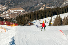 Little skier with helmet in sunny Ski Slope royalty free stock photo
