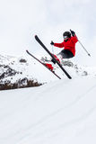 Little skier jumping in the snow. stock photography