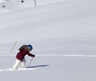 Little skier on off-piste slope with new fallen snow at nice sun Royalty Free Stock Photography