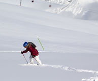 Little skier on off-piste slope with new fallen snow at sun day Royalty Free Stock Images